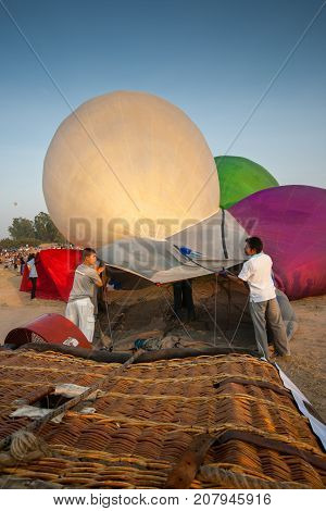 Chonburi, Thailand - December 12, 2009: Crews prepare hot air balloon cold inflation before fly in hot air Thailand International Balloon Festival 2009