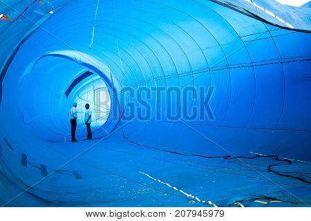 Chonburi, Thailand - December 12, 2009: Inspectors walk inside the balloon to check before take off in hot air Thailand International Balloon Festival 2009