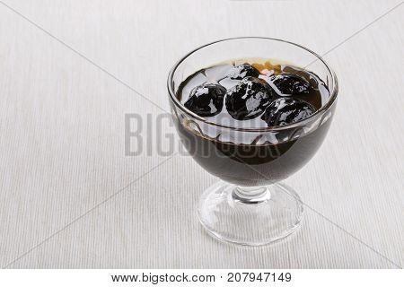 Walnut jam from young green walnut. Copy space.
