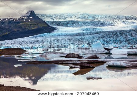 The largest glacier in Iceland - Vatnajokull in the summer sunset. The concept of extreme northern tourism. Glacier provides water Ice Lagoon Jokulsarlon