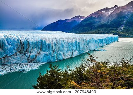 Stunning glacier Perito Moreno in the Patagonia. The concept of active and extreme tourism. Argentine province of Santa Cruz. The cloudy sky covers the horizon