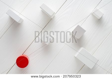 Red and white wooden blocks on white wooden background top view. Abstract background. Concept of creative logical thinking. Different geometric shapes wooden blocks on wooden background flat lay.