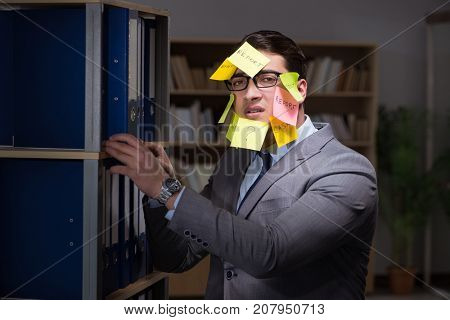 Businessman struggling with conflicting priorities during long h