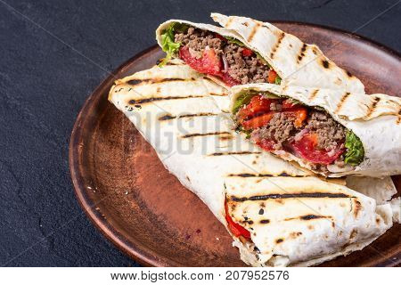 Homemade tasty burrito with vegetables and beef