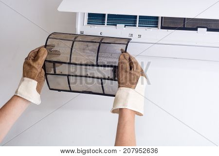 Removing dirty air conditioner filter for washing
