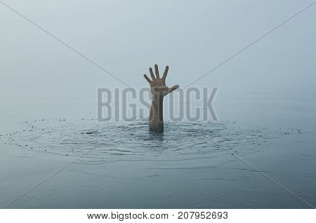 Danger, problems concept. Close up of human hand drowning in the lake
