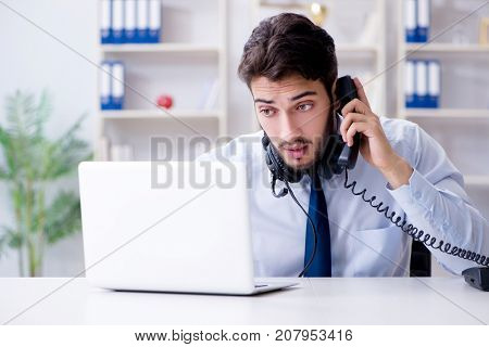 Call center employee working in office