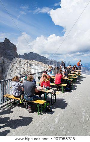 Ramsau Am Dachstein, Austria - August 17: People Sitting In Front Of Dachstein Panaromarestaurant On