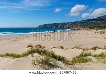 Costal view of Praia do Guincho (Guincho Beach) located on Estoril coast near the town of Cascais Portugal. This is popular blue flag Atlantic beach for surfing windsurfing and kitesurfing