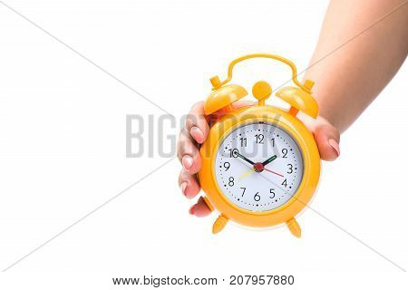 Woman Holds An Alarm Clock In Her Hands Isolated