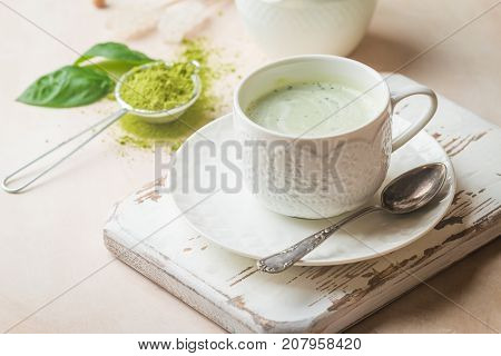 Green tea matcha latte cup on light background. Concept of a healthy diet, superfood, antioxidant, cleansing