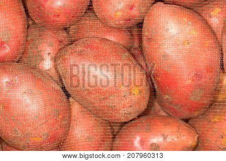 potatoes in the bag . Photo of abstract background