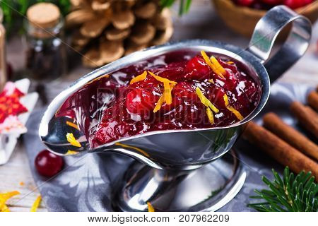Cranberry sauce in a stainless steel sauce pan on festive christmas background