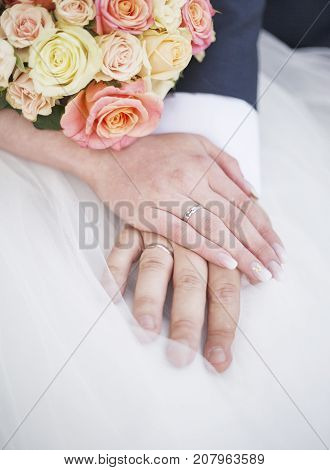 newlyweds hands with wedding rings. Bride and groom