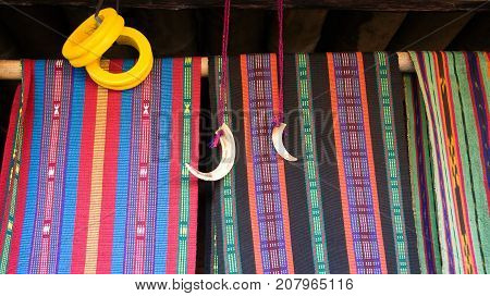 Colorful woven fabric in Bena a traditional village with grass huts of the Ngada people in Flores near Bajawa Indonesia.