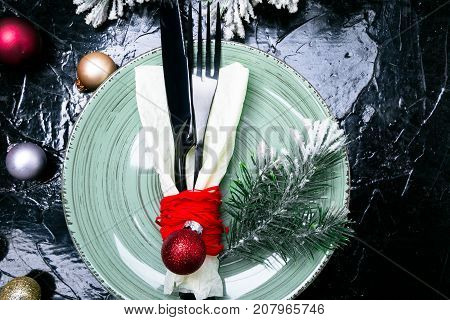 Christmas Table Place Setting. Holidays Background. Green Plate, Knife And Fork With Christmas Decor