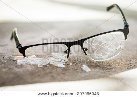 Broken Glasses On The Asphalt