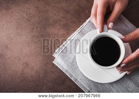 Woman Holds A White Cup Of Coffee