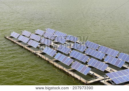 the solar panel floating on the water at the dam. conservative energy system by solar energy.