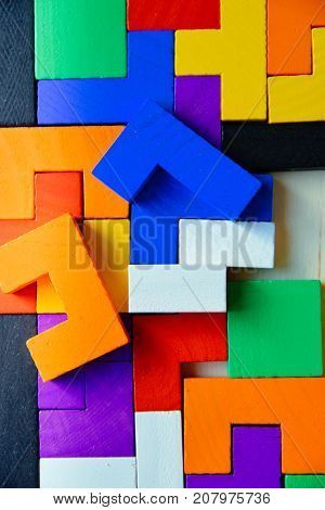 Wooden colorful shapes, blocks closely. Wooden game, abstract puzzle in many colors. Pastime. Colorful photo for posters, prints, design, interior decoration, wallpapers, scrapbook.