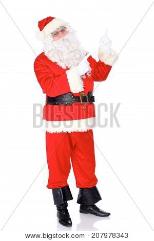 Santa Claus gesticulate while standing straight, isolated over white background. Winter Merry Christmas or New Year concept.