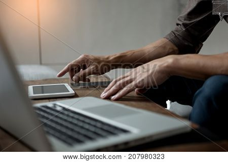 Modern Businessman With Tablet Computer Reading News And Work Report Document At Morning In Cafe.