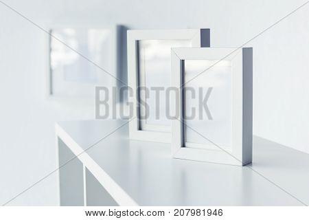 Empty Photo Frames On Bookshelf