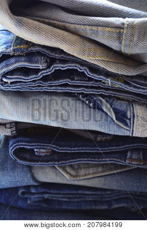 denim closet, clothing of denim fabrics of different colors and textures, a classic trend in clothing, classic denim