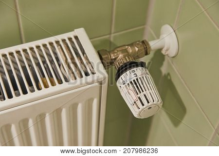 Heating radiator detail against orange wall