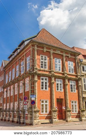 LUNEBURG, GERMANY - MAY 21, 2017: Colorful orange house in the historic center of Luneburg Germany