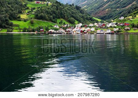 Reflection of a small town in a norwegian fiord, Norway
