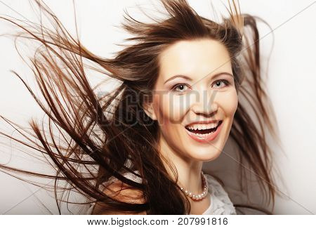 lifestyle and people concept: Beautiful adult woman with wind in