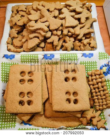 Freshly baked pieces of gingerbread house and gingerbread.