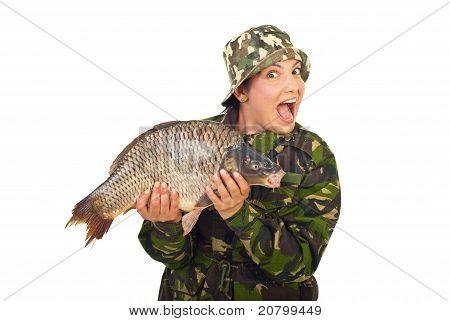 Amazed Fisher Woman Holding Big Carp