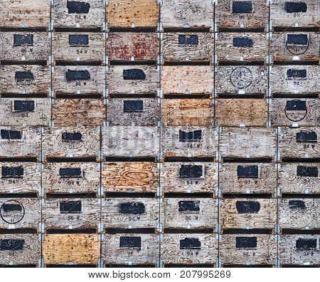 Huge stacks of wooden crates await the apple harvest in Washington State. Some of the boxes have marks indicating Quality Apples.
