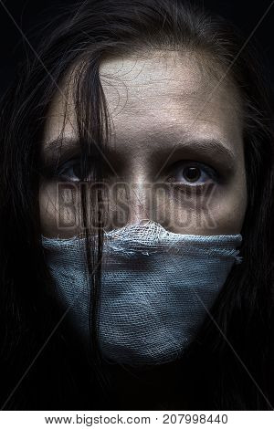 wounded woman with wounded face looking at camera