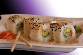 Sushi on a white plate with soy sauce and ginger poster