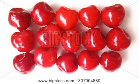 Sweet Red  Cherries Isolated On White Background. Sequentially Stacked Ripe Berries Like A Carpet