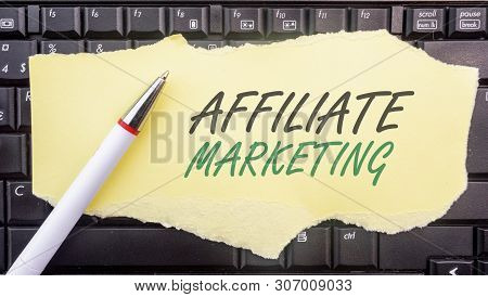 Affiliate Marketing. . Paper Width Words Affiliate Marketing And Pencil On Laptop Keyboard