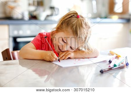 Cute Little Baby Toddler Girl Painting With Colorful Pencils At Home. Adorable Healthy Happy Child L
