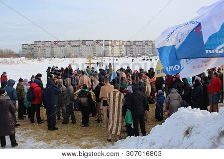 Russia, Novosibirsk January 19, 2019; Orthodox Holiday Baptism In Russia A Crowd Of Naked People Plu