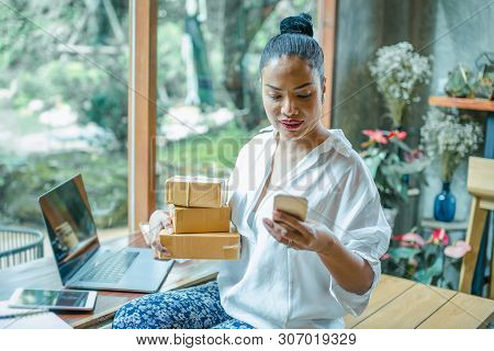 Online Shopping Young Start Small Business In A Cardboard Box At Work.women Are Preparing Products T