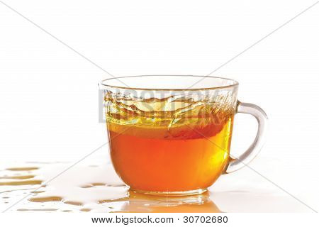 Cup of ice tea and lemon with splash