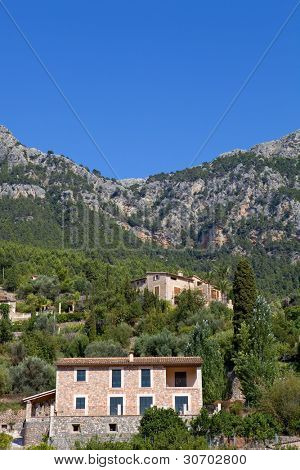 picturesque and historic village of Deia in the Tramuntana mountains, Mallorca, Spain poster