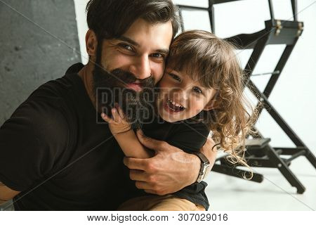 Father Playing With Young Son In Their Sitting Room At Home. Young Dad Having Fun With His Children