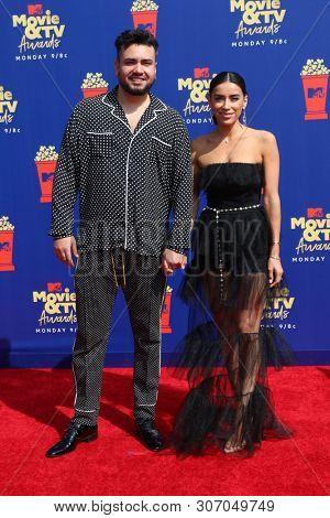 LOS ANGELES - JUN 15:  Frankie Delgado, Jen Delgado at the 2019 MTV Movie & TV Awards at the Barker Hanger on June 15, 2019 in Santa Monica, CA