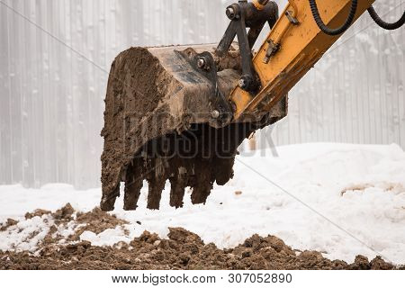 Close-up Of A Construction Site Yellow Excavator. House Construction. New Housing, Excavation, Road