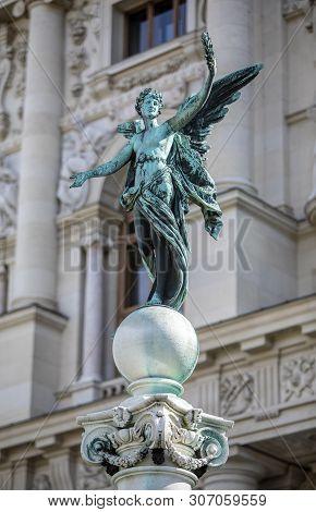 Viena, Austria - March 18, 2019: Iron Sculpture Of Angel On The Kunsthistorisches Museum Background