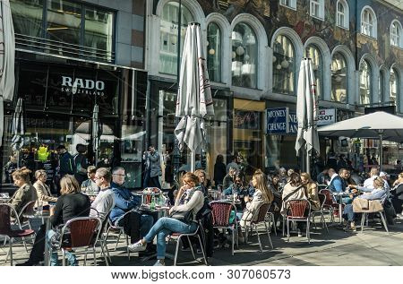 Viena, Austria - March 18, 2019: Relaxed People At The Cafe On The Central Viennese Street