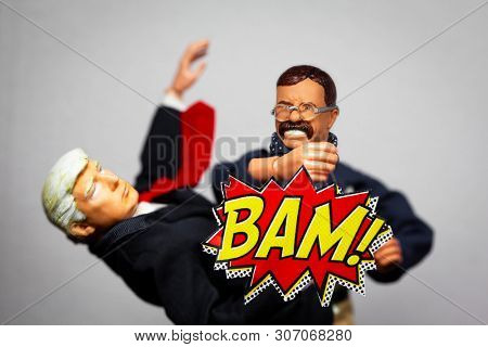 JUNE 16 2019:  Caricatures of President Theodore Roosevelt punching President Donald Trump with cartoon style 'bam' - Hasbro and Stevenson Entertainment Group action figures